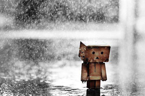 Sad Man Walking Alone in Rain
