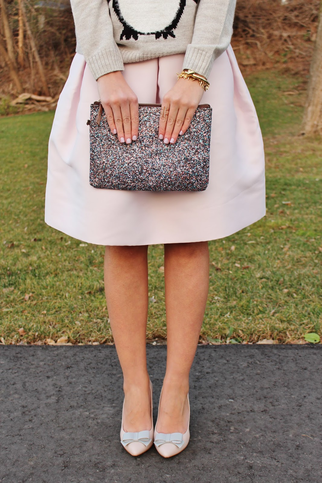 Bijuleni- What to Wear to a Holiday Party: Pastel skirt and penguin top