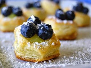 http://www.krisztinawilliams.com/2015/05/blueberry-lemon-puff-pastry-bites.html