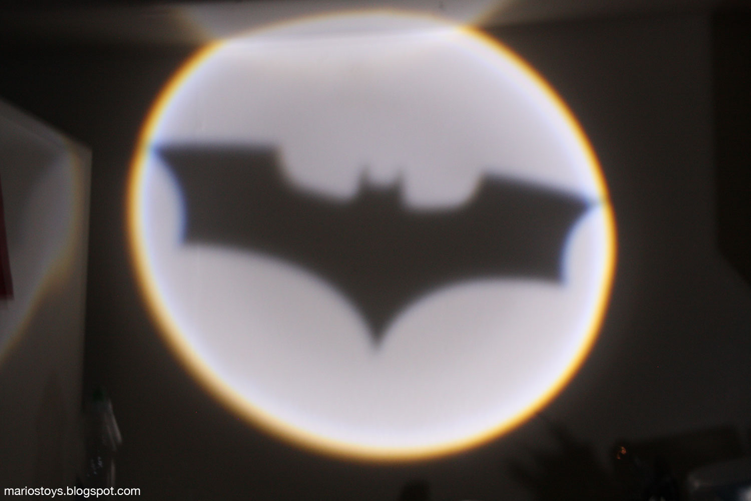 A year of toys 83 the dark knight rises movie masters heres the batsignal in action in my kitchen its hard to properly focus in the dark so its a bit sharper than the picture suggests buycottarizona