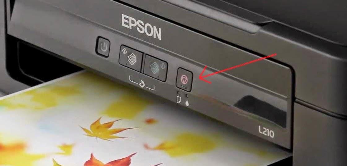 botón de impresora epson, triangulo dentro de circulo
