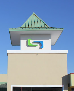 Green and blue logo with front-lit LED channel letters