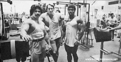 ED CORNEY, ARNOLD SCHWARZENEGGER AND ROBBY ROBINSON DURING TRAINING AND FILMING OF PUMPING IRON - GOLDS GYM VENICE, CA 1975 Robby's CONSULTATION Services to answer your questions about bodybuilding,  old schoold training and healthy lifestyle - ▶ www.robbyrobinson.net/consultation.php