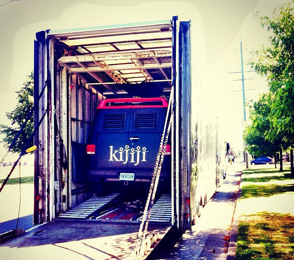 Kijiji promo van being unloaded from transport truck