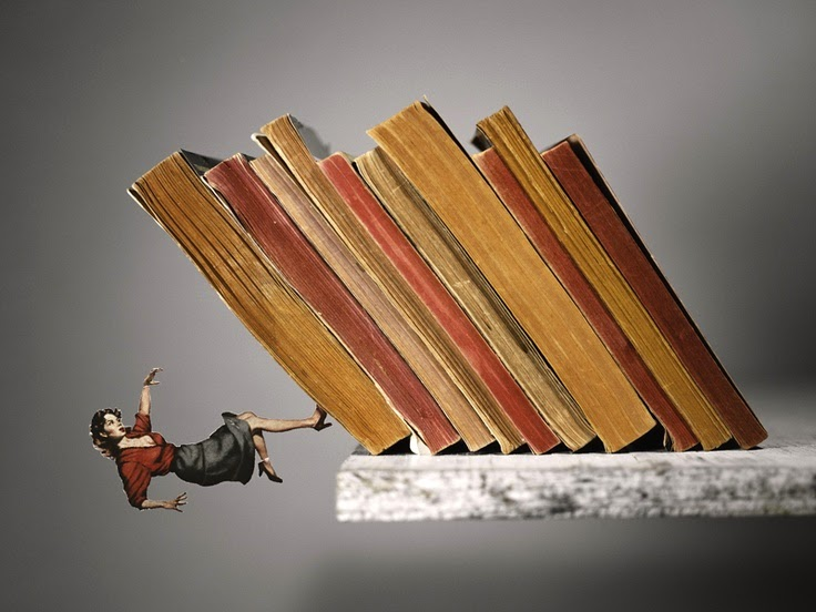 22-Topple-Thomas-Allen-Photographs-of-Cut-out-Book-Art-www-designstack-co