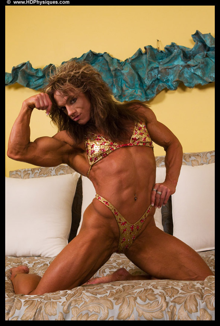 Sheila Bleck Flexing A Bicep And Modeling Her Shredded Physique