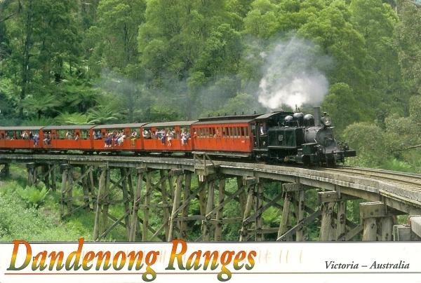 steam train crossing trestle bridge