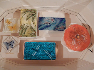 Ready to slump. The rectangular koi platter was  centered on top of the square mold and fired.