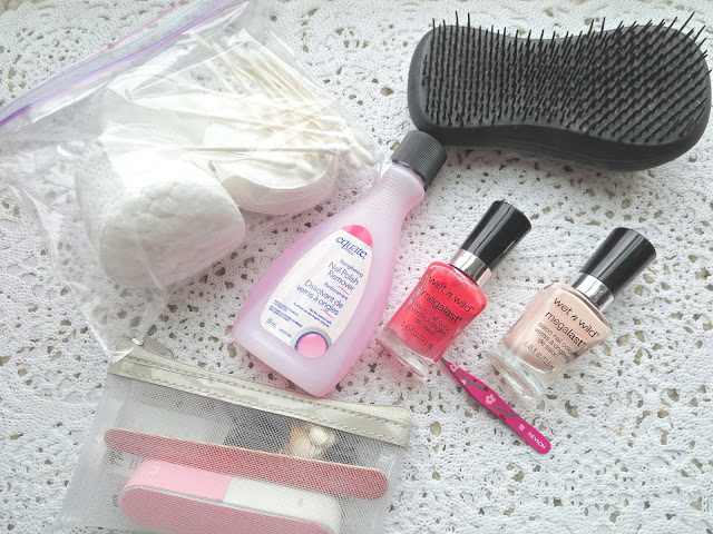 a picture of Beauty travel essentials ; cotton pads & swabs, nail polish & remover, nail kit, hair brush, tweezers