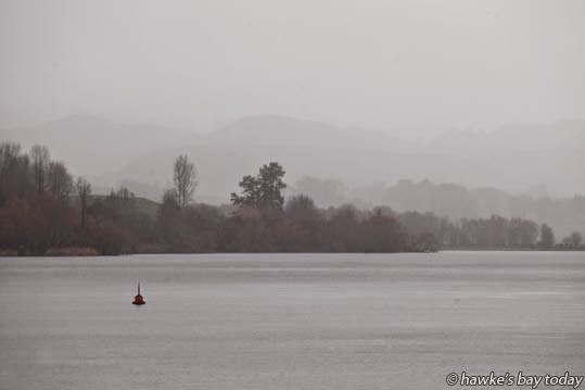 A red buoy on a grey day at Lake Tutira photograph
