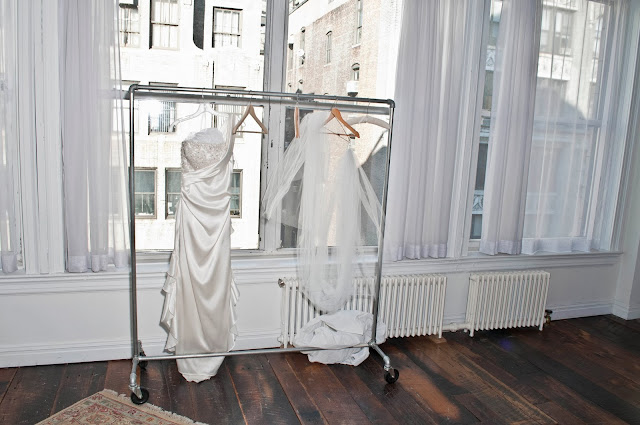 A Model Wedding, wedding gown on hanger at Gary's Lofts.