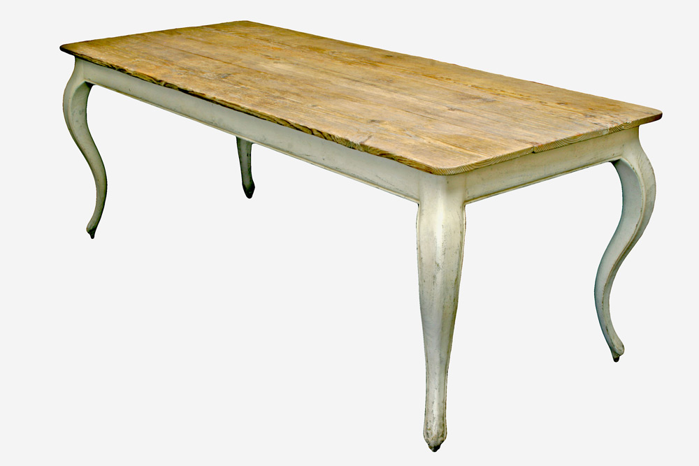 french country dining table with cabriole legs painted white, a natural salvaged wood top and antique finish