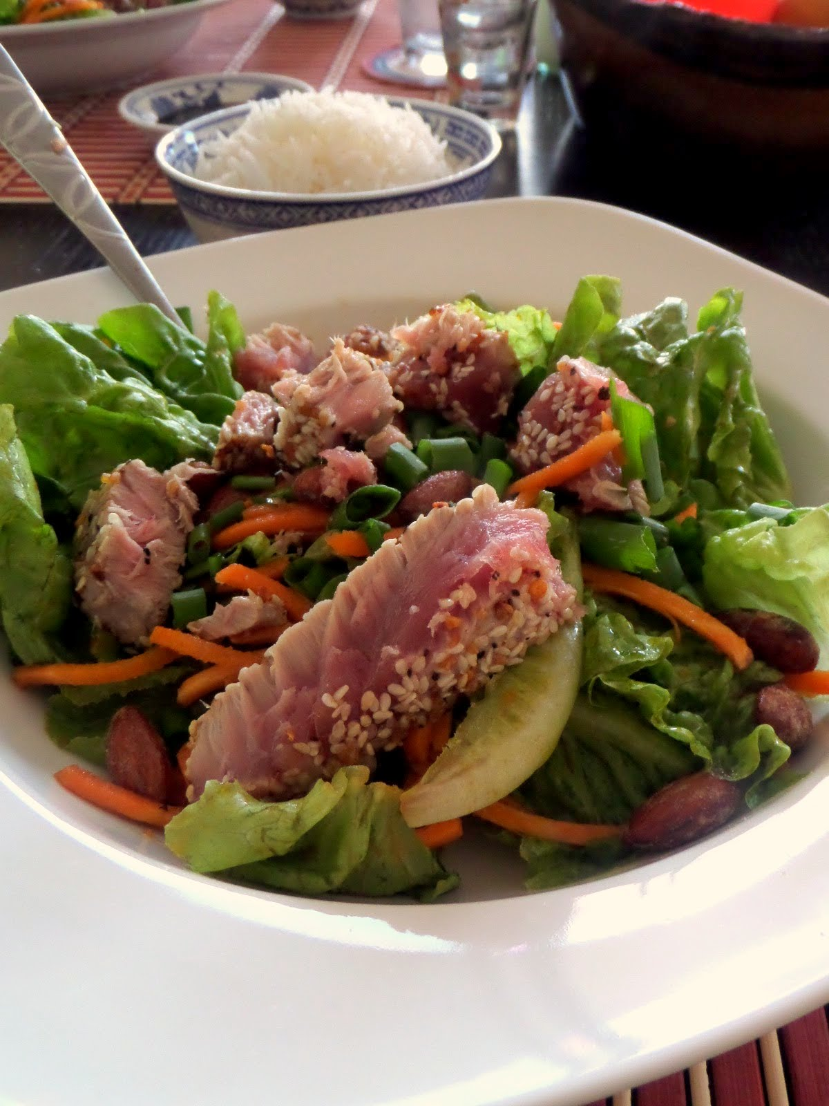 Seared Ahi Salad: Strips of seared tuna steak atop a green salad ...