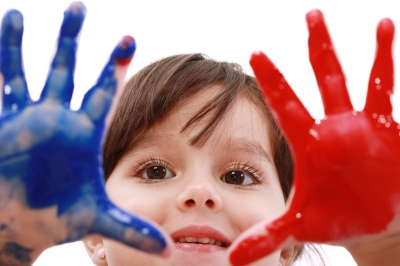 NAMC Montessori playful learning environment girl with paint on hands