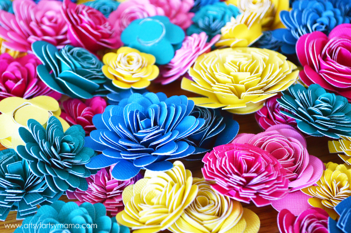 Learn to make paper flowers with your Cricut Explore at artsyfartsymama.com