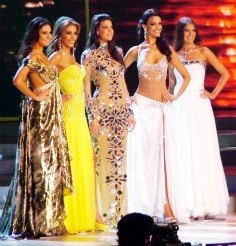 beauty pageant contenstants standing on stage
