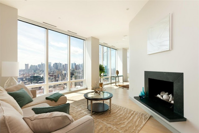 Photo of one of the rooms with fireplace in one of the most beautiful penthouses