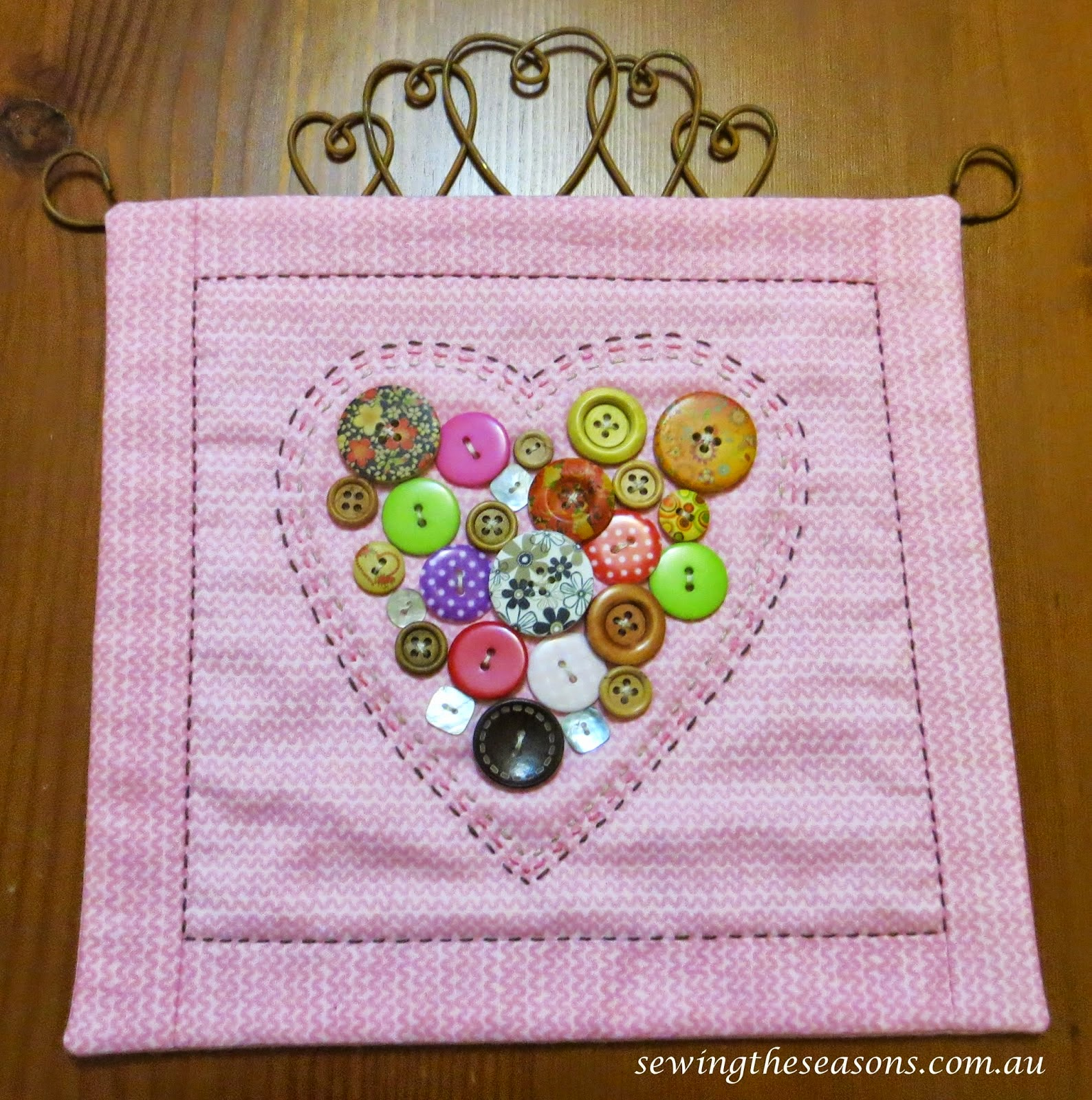 http://www.sewingtheseasons.com.au/2015/01/tutorial-button-heart-hangings.html