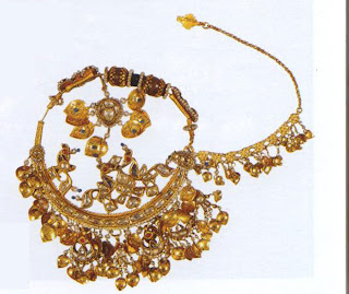Nath, nose-ring, Himachal Pradesh, 19th cent. AD  The nath or nose-ring though not part of the ancient Indian repertoire has now become a staple. The gold here is studded with gems and pearls. At the upper end, the foliage is embellished with stones, while below tiny gold leaves shimmer in the light.
