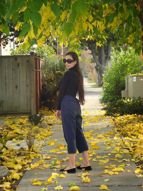 black turtleneck, cropped loose pants, prada sunglasses, black velvet loafers
