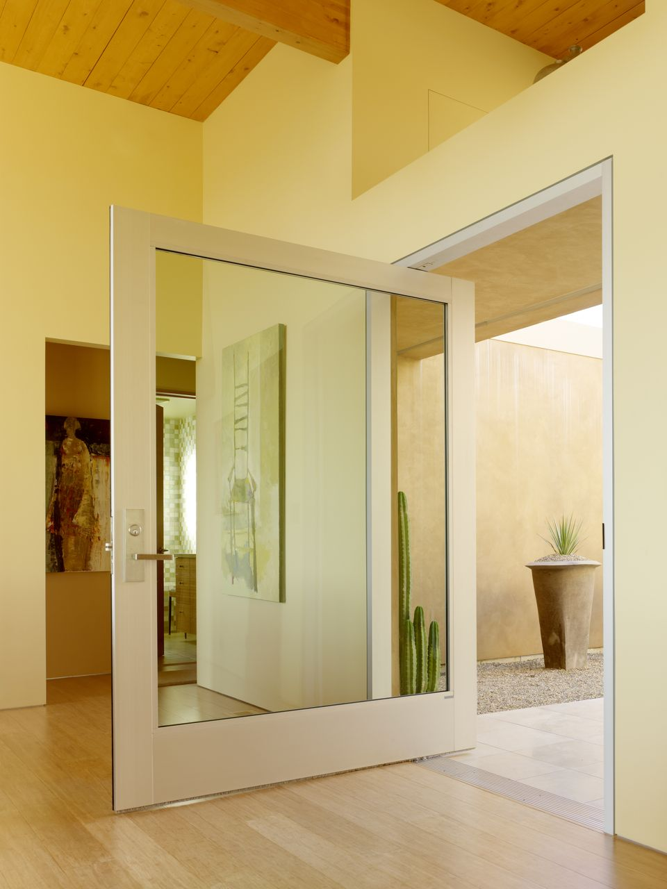 Posts and reflections on pivot doors Pivot entrance doors