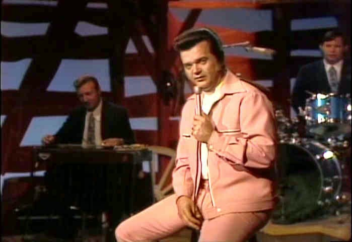 http://www.morethings.com/music/conway_twitty/conway_twitty_1974_image_gallery01.htm