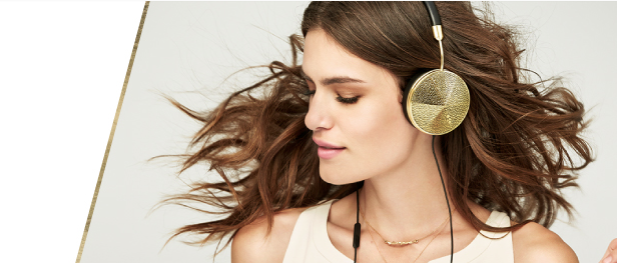 Model wearing gold over the ear friends headphones