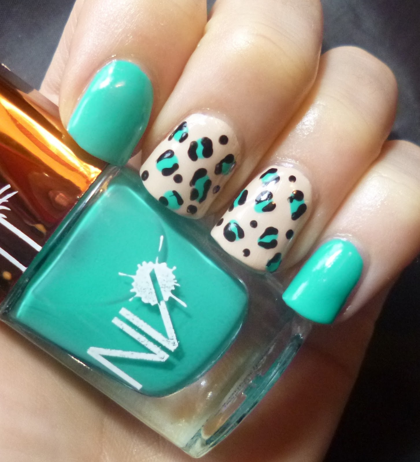 Lou is perfectly polished freehand animal accent nails for this manicure i decided to go for the double accent nail look so i painted two fingers with nv lagoon turquoise and two fingers with barry m lychee solutioingenieria Images