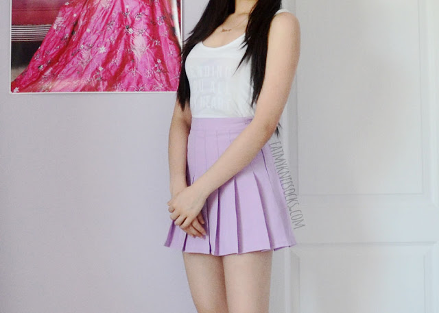 Side view of the Snapmade custom-print tank top and the American Apparel dupe purple pleated tennis skirt from Miuxin.