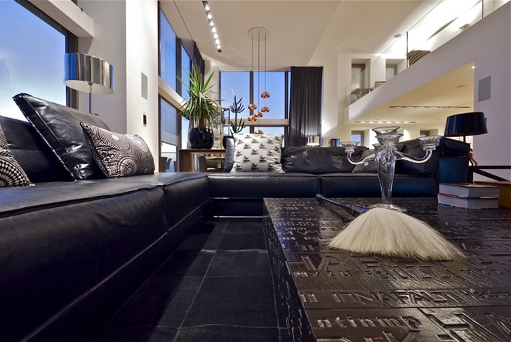 Black leather sofa in Triplex penthouse apartment by Pitsou Kedem