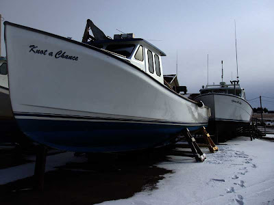 These beautiful fibreglass fishing boats are waiting on the wharf for the spring season to open.