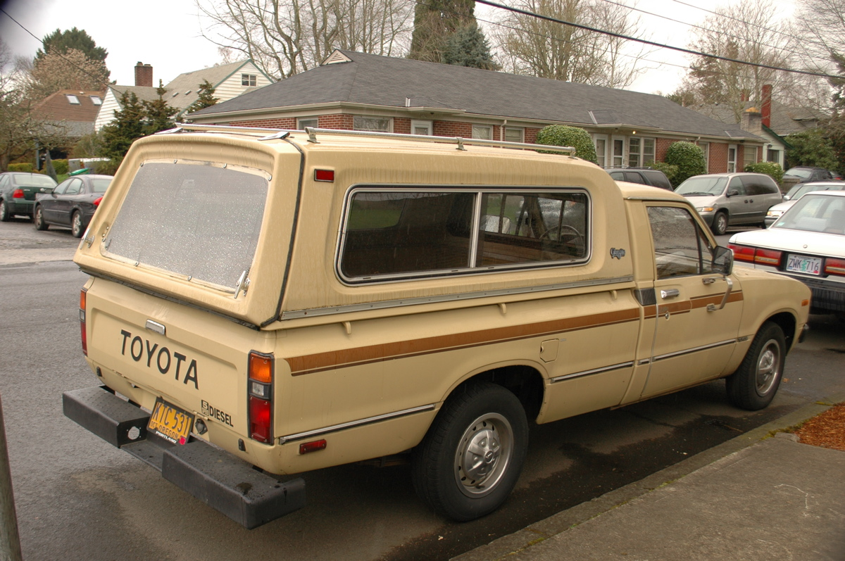OLD PARKED CARS.: 1980 Toyota Hilux 5-Speed Diesel.