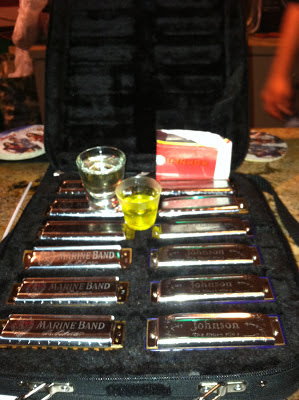 Image of a set of Marine Band harmonica's with a shot of Tequila and Pickle juice