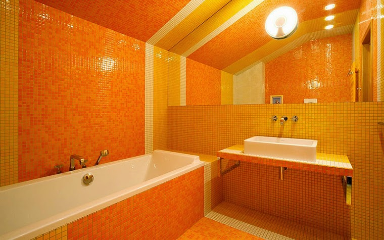 10 modern day bathroom styles and tips in orange colour for Bathroom decor orange