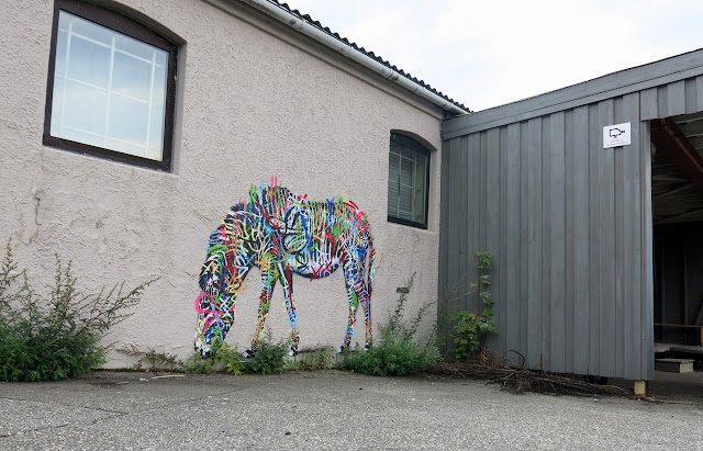 Street Art Murals By Martin Whatson In Stavanger Norway For Nuart Urban Art Festival. close up view of zebra