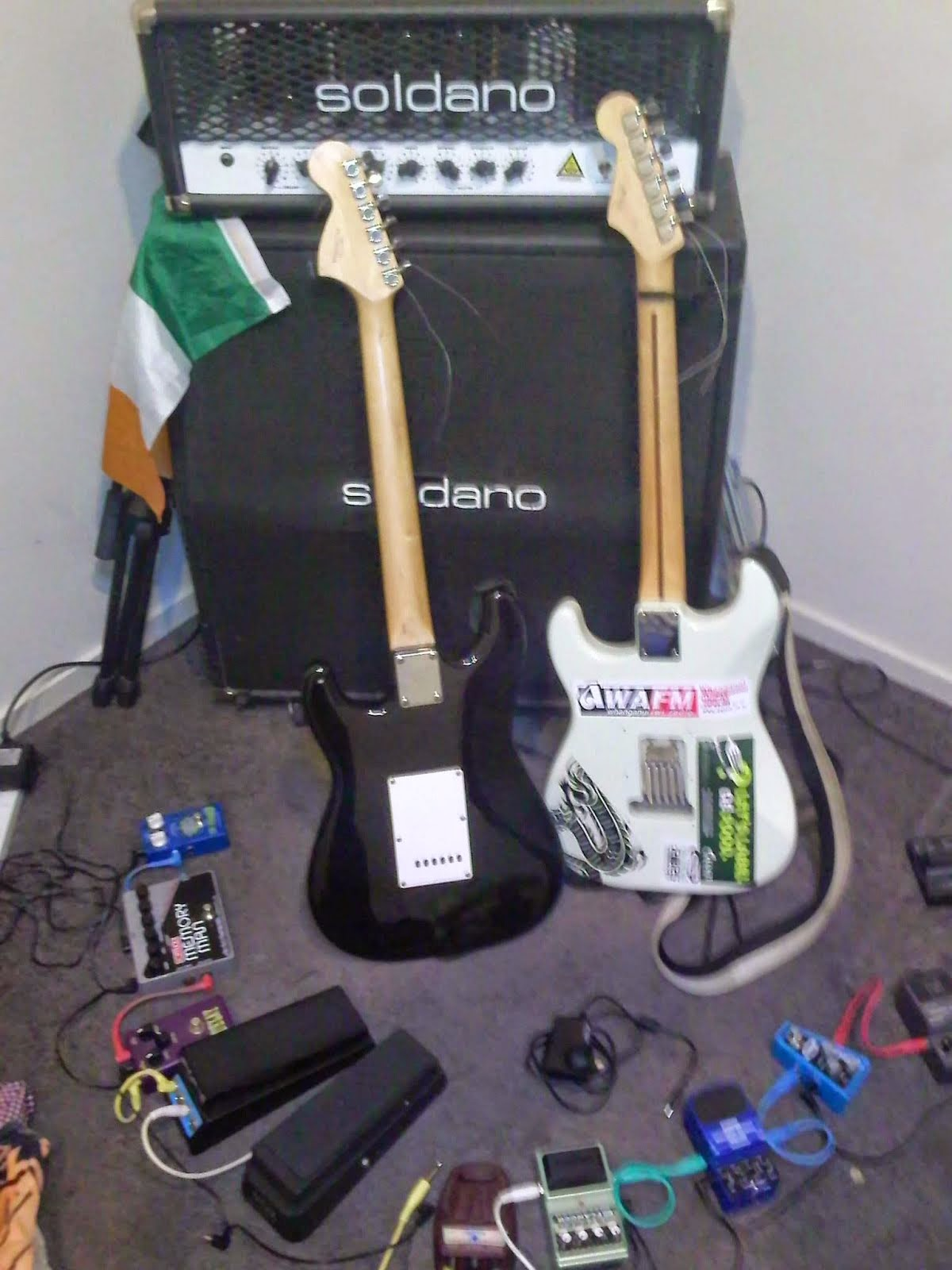 Pre bedroom jam, amplifier, speakers, guitars, and effects.