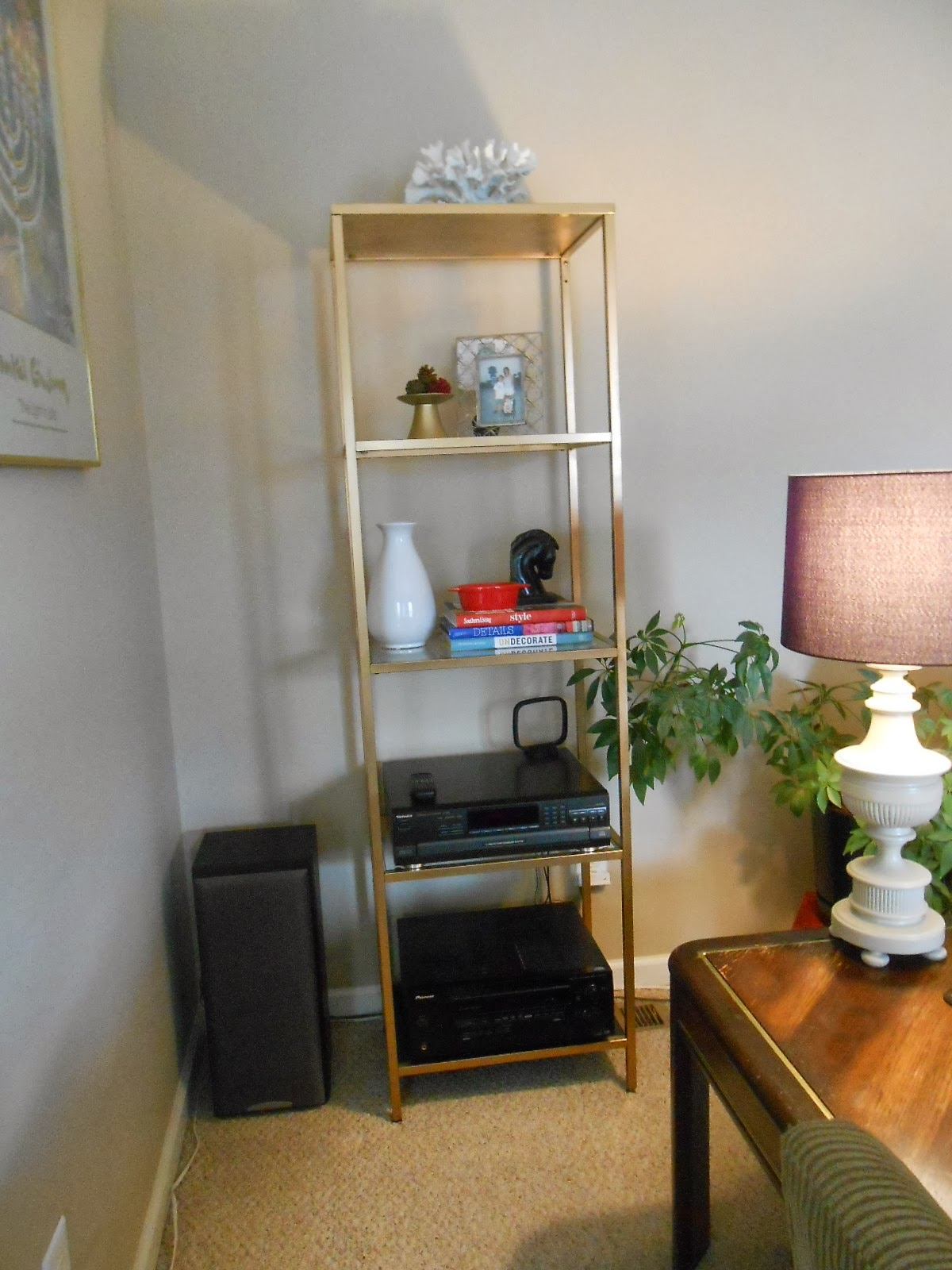 life at 818 beautiful gold shelf unit another spray. Black Bedroom Furniture Sets. Home Design Ideas