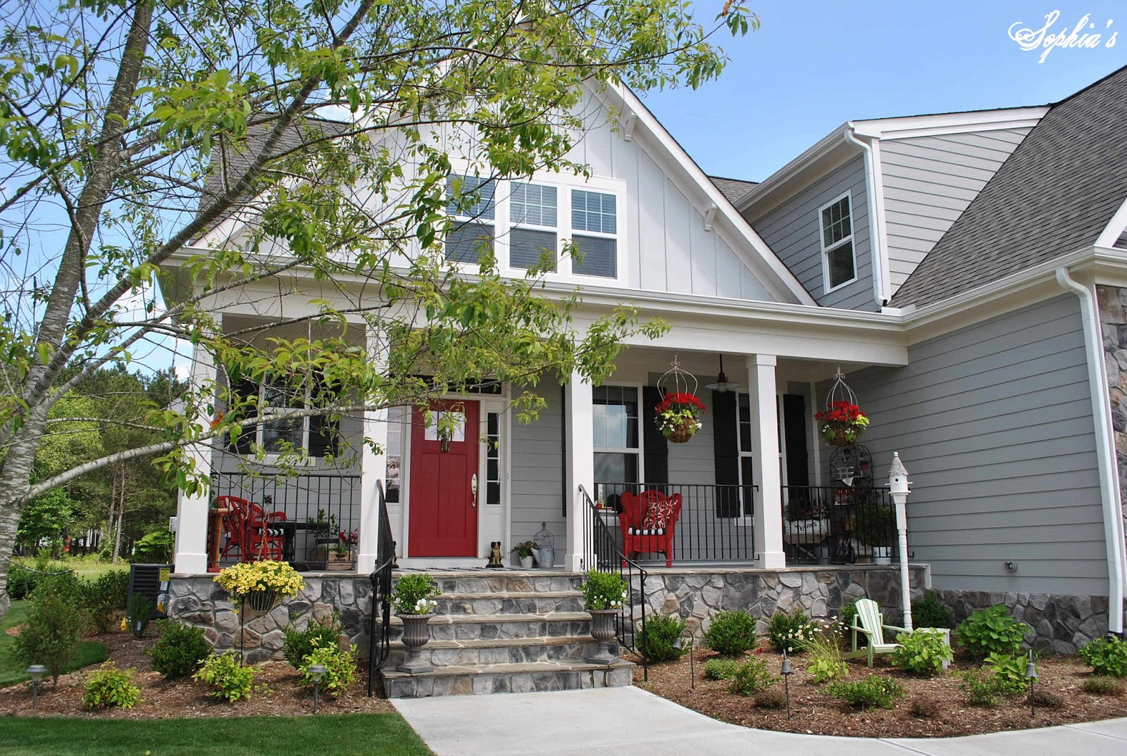 Sophia 39 s farmhouse style front porch with pops of red for Farmhouse style siding