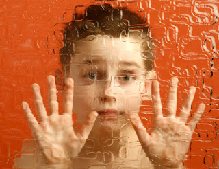 Photograph of child trapped behind glass, distorting their appearance