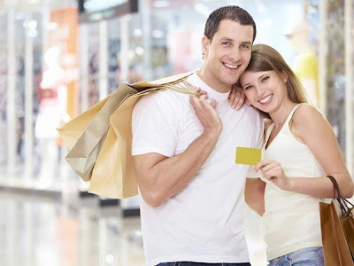Is Love Expensive - girl holding credit card - woman using man