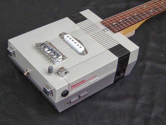 Genius repurpose of an old Nintendo console, turned into an electric guitar with effects...  AWESOME!