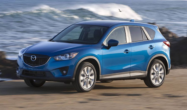 Blue 2014 Mazda CX-5 front 3/4 view by ocean.