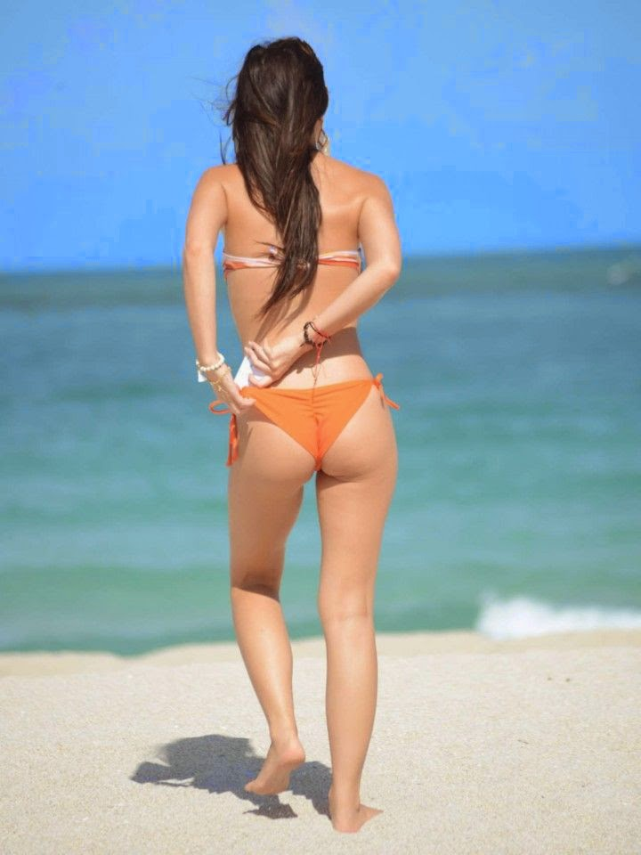 Lisa Oppie bent down to put her body in the sands as she soaked up the sunshine on Thursday, May 1, 2014 at Miami, FL, USA.