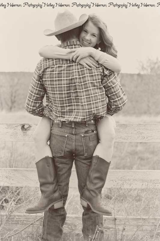 couple hugging on fence, cowboy engagement session with Levi & Cara by Ellensburg Wedding Photographer Hailey Haberman