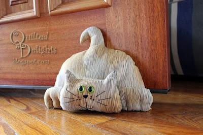 Gato peso porta