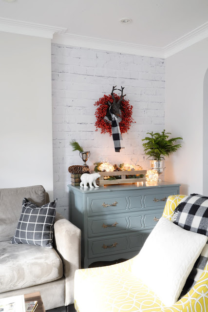 whitewashed brick wallpaper | rustic decorations | reindeer head plaid scarf | Ramblingrenovators.ca