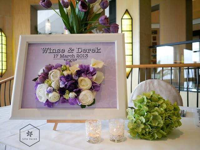 purple wedding reception decoration and welcome board