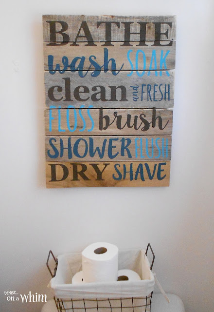 Bathroom Pallet Sign and Wire Basket for Toilet Paper| Vintage Farmhouse Bathroom Makeover | Denise on a Whim