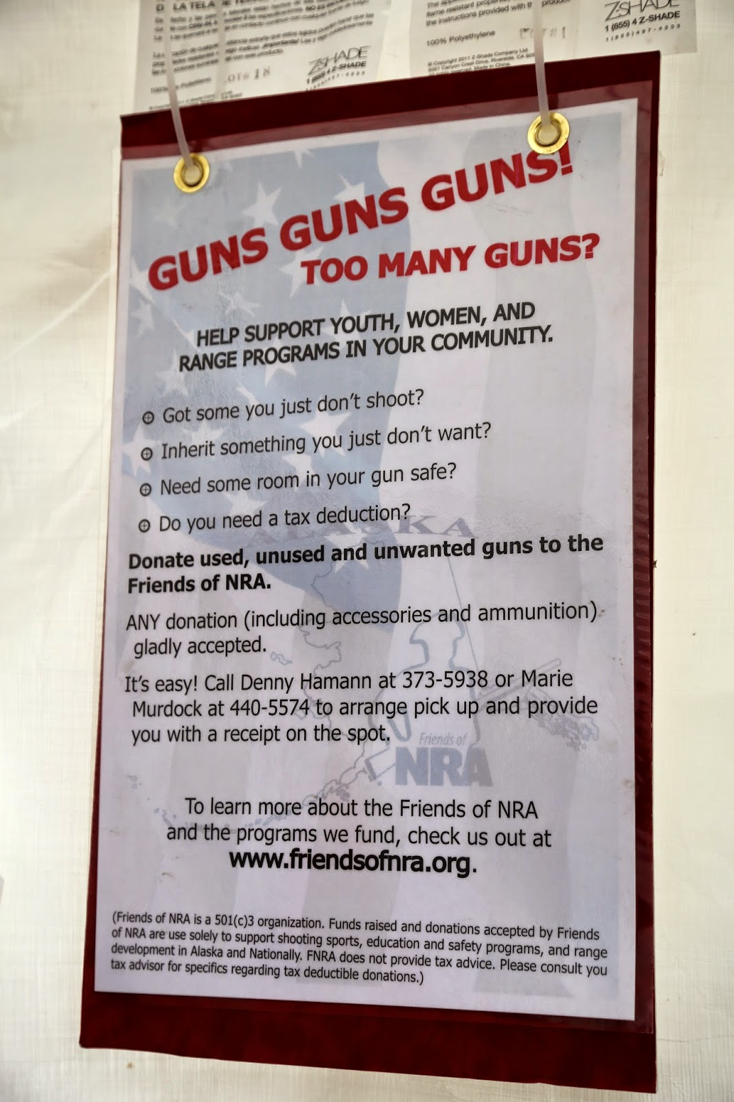 Guns for charity sign, NRA stand, Alaska State Fair