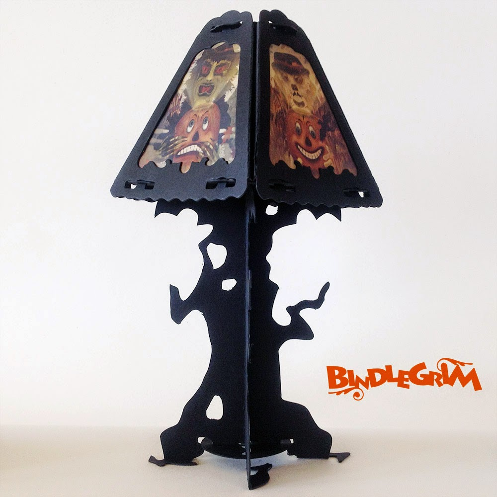 Series of Halloween lanterns in a vintage-style by artist Bindlegrim - the Spooklights featuring silhouette tree form with imagery of JOL, Witch, and Scarecrow